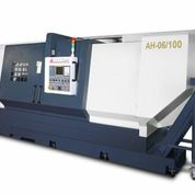 Booth S-8536: The You Ji AH-06/1000 Horizontal Lathe from Absolute Machine Tools features an extremely rigid 45 deg slant bed with a 55 deg cross slide inclination. The massive 12 station hydraulic turret handles extreme torque delivered by a 60 hp spindle motor and 3 speed geared headstock. The rigid spindle structure has a bar capacity of 6.05 in (9 in optional) with a 24 in three-jaw hydraulic chuck.