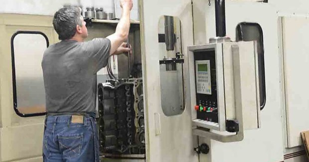 Machinist Dennis Stone uses an older Sunnen SV-3 to line hone vertically and automatically.