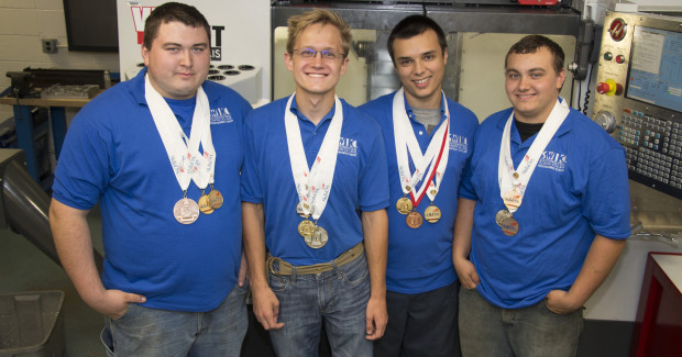 National competitors (l-r) Michael Campbell of Collinsville, Greg Kersulis of Waterloo, Michael Garcia and Charles Barger, both of Collinsville. All four are wearing medals they took this year and in previous years during SkillsUSA competitions.