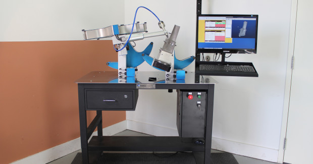 Booth E-4746: A compact, self-contained Touch Robot from Force Robots performing delicate airfoil machining. The system requires only 120 VAC and shop air to operate. It consists of a 4-axis material removal arm and a 2-axis part positioner mounted to a 1.2 m x .8 m portable work table. Dividing the system's six degrees of freedom between the two coordinated mechanisms preserves the deft touch of the tool arm while permitting manipulation of heavy castings up to 0.4 m long. (second view)