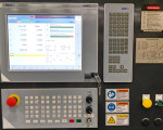 All seven axes on the 400H Series II gear hobber, including the 560 Nm work piece spindle motor, are controlled by NUMDrive C servo drives and a Flexium 68 CNC system. (first view)