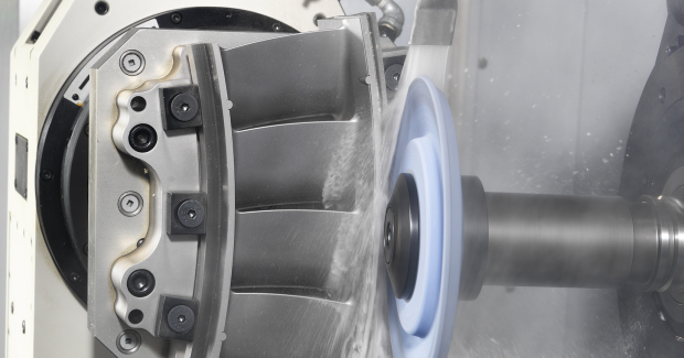 The unique two-axis Programmable Coolant Nozzle (PCN) handles variations in wheel diameter and changes in cutting direction while maintaining ideal coolant flushing conditions. It also allows for intermittent NC-controlled, electrically powered rotary dressing that trues the wheel to reestablish profile geometry on the cutting wheel.
