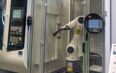 Robots were running in tandem with machine tools everywhere in the show. In the most advanced cases, the control was centralized on a single CNC. Portions of a program, whether to run the part or run the robot, were being input on independent channels of the control. No separate robot language required.