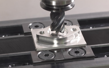 The PS95 vertical machining center can handle tight-tolerance holes and slots at ±0.0002 in with great repeatability. (first view)