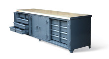 As one of the largest and strongest workbenches at 120 in x 30 in x 34 in and weighing 1,500 lb, Ultimate Workbench from Strong Hold Products features 16 deep pocket drawers that can hold 400 lb of material each and lock-bars to secure and safely store items, a lockable two-door compartment with a 3-point locking mechanism, and a built-in vise shelf for lending a third hand to the job in most welding cells.
