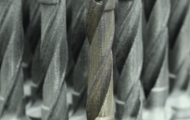 The new QTD insert drill from Mapal is manufactured by additive laser melting in diameters from 8 mm to 32.75 mm with a new steel tool body design that has spiral cooling channels not usually used for small diameters. The tool shank is machined conventionally and the drill is additive laser melted. (Photo courtesy of Mapal) (first view)
