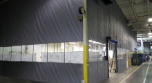 Flexible, easy-to-install fabric curtain walls effectively separate processing areas from clean/finishing areas. Curtain walls can easily be reconfigured to fit facility layout changes. They are less expensive to install than hard walls and create an enclosure seal just as or even more effective than a hard wall. Standalone, high-speed roll-up doors in the curtain wall allow efficient thoroughfare and minimize time the interior is open to the processing area.