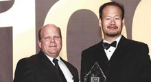Lonnie Love, a senior research scientist for ORNL (left), and Carey Chen, the chief executive officer and president of Cincinnati Incorporated, accept the award.