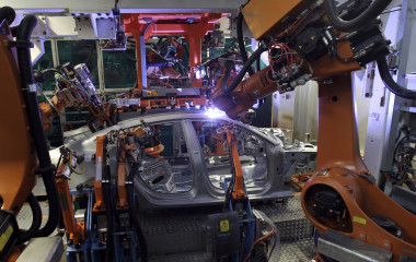 Robots braze the car body of an Audi A5 at the production line on in Ingolstadt, Germany. Once finished, laser brazed seams become virtually undetectable and are used to build previously difficult – if not impossible – car shapes. (Photo by Miguel Villagran/Getty Images)