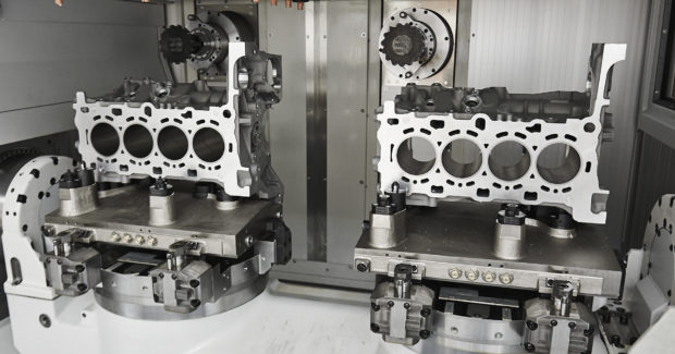 Cylinder blocks with adapter plate being machined on a two-spindle SPECHT 500 DUO 5-axis horizontal machining center from MAG.