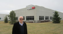 Dr. Giuseppe Morfino, the chief executive officer of Fidia, stands in front of their new facility in Rochester Hills that expands their North American operation to over 20 employees.
