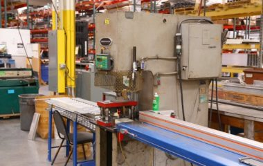 United Enertech uses a material positioning system from TigerStop for quick, accurate punching of parts. The versatile positioner connects to the existing press for punching repeated patterns in nearly an autonomous operation. The operator verifies the required pattern and then programs it into the TigerStop, where the Advanced Interconnect Kit allows it to run through that program and punch the desired pattern without needing to stop and verify each hole. This provides an infinite range of adjustability without making a mechanical index and saves much in labor.