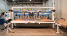 Manufactured for industrial use, Jet Edge waterjet shuttles are available in a High Rail Gantry format supporting up to 12 cutting heads or a Mid Rail Gantry format supporting up to four cutting heads. (High Rail Gantry format pictured)