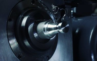 The RapidTurn  5C CNC chucker lathe attachment shown cutting. After initial installation, set-up takes just a few minutes and is just as easily stored out of the way when not in use. Turning and milling is accomplished in one setup using a manual index plate with a locking pin.