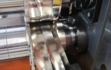 The thinnest-possible aluminum or copper panels, only around 0.03 mm to 0.3 mm thick, are processed into narrow strips for use in coils and transformers. Because the properties of these materials create very challenging demands, the slitting machine can only apply very low belt tension to ensure a unified coil pattern and limit the risk of edge bow curvature. (Photo courtesy of Alcotec Aluminium Coil)