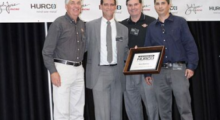 Pictured (l-r) Fred Braun, Scott Camloh, Jim Braun and Tim Navalta stand on stage during the presentation of the Top Hurco Distributor Award that was won by Braun Machinery.