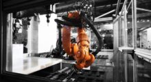 A KUKA robot in a Fastems flexible manufacturing system. Fastems provides robot based automation solutions for customers in machinery construction, aviation and aerospace as well as metal working companies and their suppliers.