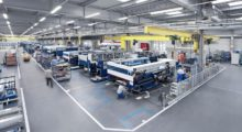 The machine tool assembly line at the TRUMPF plant in Ditzingen, Germany, is part of their SYNCHRO production system that is a successful example of Lean manufacturing. SYNCHRO stands for the Synchronization of man, machine, market, and material. This Lean system applies the key principles of continuous improvement to ultimately synchronize production. (first view) (Photo courtesy of TRUMPF)