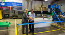 Ribbon cutting to inaugurate the new WARDKit 5x5 waterjet cutting system at the Rock Mechanics and Explosives Research Center on the Missouri S&T campus.