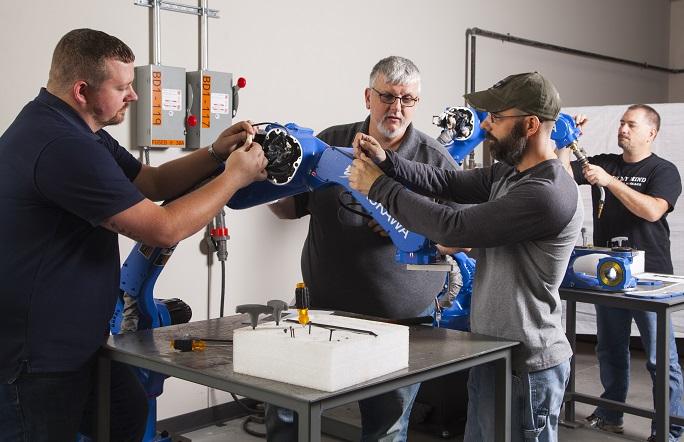 self integrating a robotic welding system rh fabricatingandmetalworking com Robot Training Classes Motoman Robotic Welding